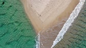 hava : Aerial Drone Footage Of Waves Rushing the Beach. australia Stok Video