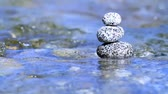 meditation : Stacked stones in a river.