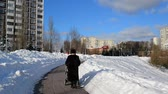 administrativo : woman with stroller walks on the boulevard in Moscow, Russia.