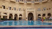 emirados Árabes unidos : Ajman, UAE - April 11. 2018. Swimming pool in front of hotel in Bahi Palace Vídeos