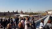 new urbanism : Moscow, Russia - April 14. 2018. people on flying bridge in park Zaryadye Stock Footage
