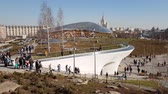 new urbanism : Moscow, Russia - April 14. 2018. Glass bark and amphitheater in park Zaryadye Stock Footage