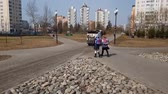 district : Moscow, Russia-April 24.2018. children and cleaning machine on boulevard city Stock Footage