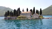 santi : Natural islet with Saint George Benedictine monastery. Kotor Bay. Montenegro Filmati Stock