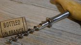 pub : vintage old corkscrew and rolling wine cork with inscription bottled in France