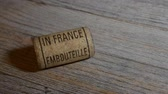 engarrafado : vintage old corkscrew and rolling wine cork with inscription bottled in France