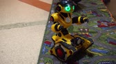 Belarus, Minsk, Robot Exhibition, June 3, 2019: childrens toy robot tractor man rides in room close-up and smiling