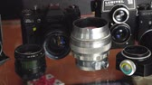 Belarus, Soligorsk, July 1, 2019: many old variety of Soviet film analog retro cameras and lenses close-up in photo studio or museum close-up