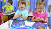 picture : Happy Kids Painting at Kindergarten