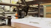 folding machine : Feed on an automated paper folding machine in a print shop