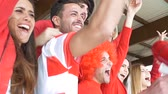 gritando : Football supporter friends cheering and watching soccer match at the intenational stadium Stock Footage