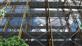 scaffolding : Building under construction, scaffolding and Safety First signboard.