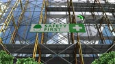 uithang bord : Building under construction, scaffolding and Safety First signboard.