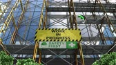 szyld : Building work in progress with scaffolding and signboard. Wideo
