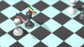 schaakstuk : Chess Pawn with country flag, United States, Iran. Stockvideo