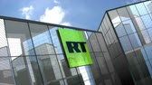 televizyon : April 2019, Editorial RT TV Network logo on glass building. Stok Video