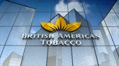 şirket : December 2017, Editorial use only, 3D animation, British American Tobacco plc logo on glass building. Stok Video