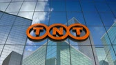 şirket : March 2018, Editorial use only, 3D animation, TNT Express logo on glass building.