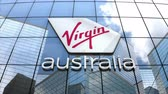 szűz : May 2018, Editorial use only, 3D animation, Virgin Australia Airlines logo on glass building. Stock mozgókép