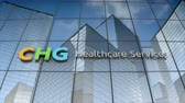 servis : September 2017, Editorial use only, 3D animation, CHG Healthcare Services logo on glass building. Stok Video