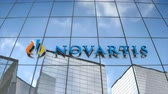 Editorial use only, 3D animation, Novartis logo on glass building.