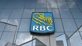 şirket : Editorial use only, 3D animation, Royal Bank Canada logo on glass building.