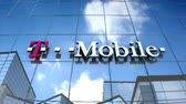 telekomünikasyon : Editorial use only, 3D animation, TMobile logo on glass building.