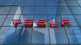 автомобили : Editorial use only, 3D animation, Tesla logo on glass building.