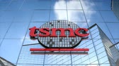 Editorial use only, 3D animation, TSMC logo on glass building.