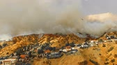 wealthy : Wildfire in neighborhood as rescue helicopter drop water Stock Footage