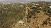 wealthy : Aerial tilt down view of Mulholland Drive in the Hollywood Hills Stock Footage