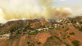 wealthy : Smoky wildfire in California neighborhood