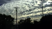 greyhound : Crazy skies and moving silhouette through Los Angeles from train, Stock Footage