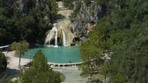 Steady wide shot of Turner Falls with the natural swimming pool below it Dostupné videozáznamy