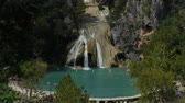 высокий : Steady wide shot of Turner Falls with the natural swimming pool below it Стоковые видеозаписи