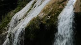 Close up of water cascading down a beautiful waterfalls Dostupné videozáznamy
