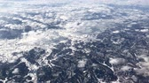 하늘 : Hand-held shot of a winter scene with snow blanketing the landscape over Manitoba, Canada