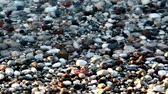 elegance : Shot in HD with macro focus on pebbles at the beach as the surf washes over sunset.high quality HD video footage Stock Footage