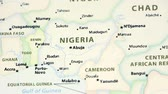 woman s day : Nigeria on the political map of the world. Video defocuses showing and hiding the map.