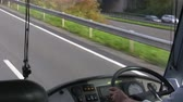 greyhound : Bus driver is driving a bus. View of steering wheel, hands and motorway on the move Stock Footage