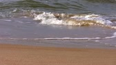 wet : Close up of sea waves breaking on the sandy beach