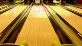 bowling alley : Ball rolling down the lane toward ten pins pushed from kids bowling ramp. Stock Footage