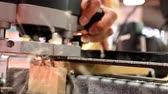 зажимное приспособление : Carpenter is cutting a dovetail shape joint using electric power tool scribing jig, close up