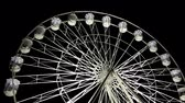carnívoro : Amusement park ride, illuminated white ferris wheel or observation wheel is spinning against black sky background, front view Stock Footage