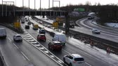 gantry : MANCHESTER, ENGLAND, UNITED KINGDOM - FEBRUARY, 2018: Traffic flow under unfinished highway gantry on Manchester orbital road at a junction in winter