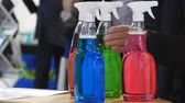 agd : Client or buyer is discussing about colorful colourful cleaning product with a merchant