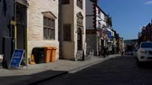 celta : CONWY, WALES, UNITED KINGDOM - JUNE, 2017: Panning shot of street with shops and pub decorated with Welsh flags in an old town of Conwy in North Wales
