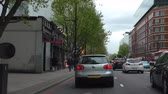 taksi : LONDON, ENGLAND, UNITED KINGDOM - APRIL, 2017: Car front window view while driving on busy Euston Road in central London.Stopping at pedestrian crossing by British Library