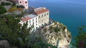 sarma : View from above of cars driving dangerous seaside road on the cliff in Atrani town of Amalfi coast, Italy Stok Video