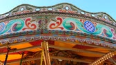 szórakoztatás : Carousel Merry-go-round stopping spinning; top of the ride against blue sky view